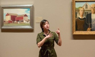 A guide leads a tour in sign language. (Photo courtesy of The Art Institute of Chicago.)