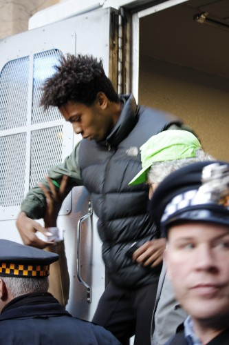 16-year-old Lamon Reccord is released after being briefly detained by police during a protest Wednesday. (Kirsten Onsgard / The DePaulia)