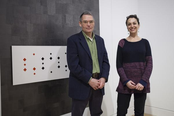 """Artists Richard Rezac, left, and Dianna Frid with one of their sculptures from their exhibit """"Dianna Frid & Richard Rezac: Split Complementary"""" Monday, Jan. 25, 2016, at the DePaul Art Museum. """"Dianna Frid and Richard Rezac: Split Complementary"""" brings together recent works by both artists that are displayed alongside rare books from the Special Collections of DePaul University's John T. Richardson Library and a variety of objects from the DePaul Art Museum's permanent collection. The juxtaposition of objects made by artists, craftspeople, and bookbinders generates affinities that broaden how we see and understand all of the work assembled. (DePaul University/Michael McAfee)"""