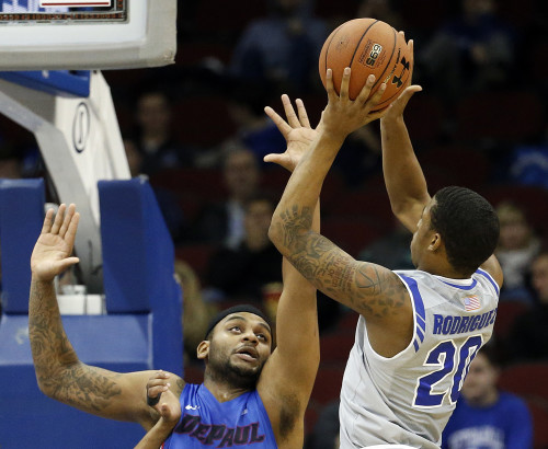 Seton Hall forward Desi Rodriguez (20) goes up for a shot against DePaul center Tommy Hamilton IV (2) during the first half of an NCAA college basketball game, Saturday, Jan. 2, 2016, in Newark, N.J. (AP Photo/Julio Cortez)