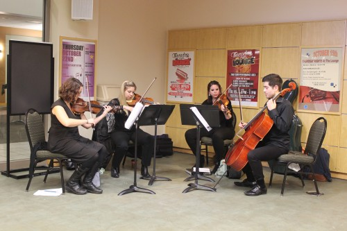 "A string quartet consisting of DePaul students Emily McClean, Danielle Simandl, Dana Debofsky and Joshua Dema played themes from the ""Harry Potter"" series for attendees of DAB'S DePaul After Dark event. (Maddy Crozier / The DePaulia)"
