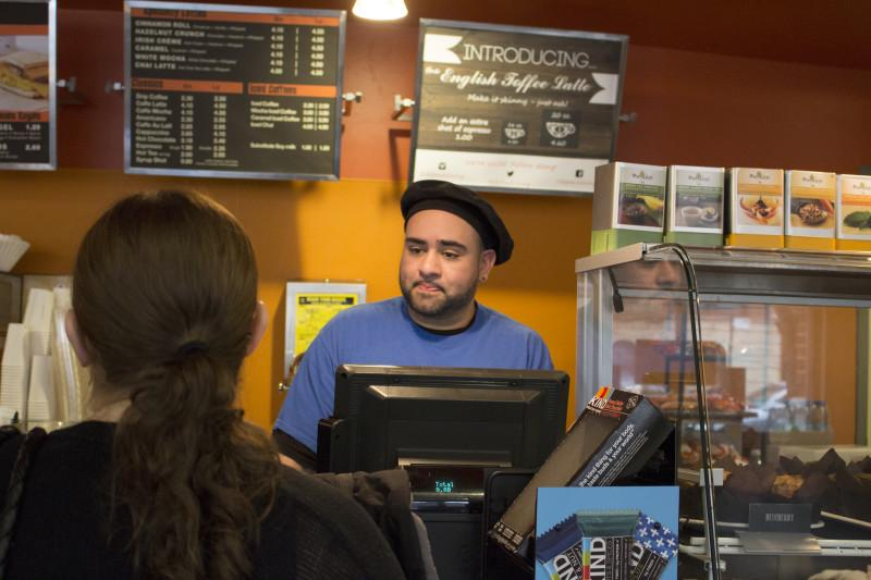 DePaul senior Tony Romero works at Brownstones at the Student Center in the Lincoln Park campus. Romero was housing insecure before securing housing through DePaul. (Megan Deppen / The DePaulia)