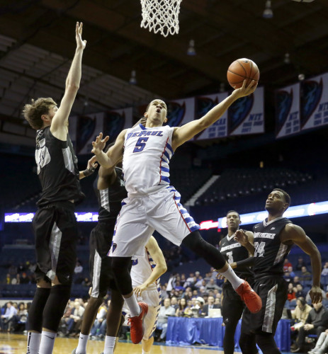 DePaul guard Billy Garrett Jr. (5) shoots against Providence guard Ryan Fazekas, left, as Providence's Kyron Cartwright (24) watches during the second half of an NCAA college basketball game Tuesday, Feb. 2, 2016, in Rosemont, Ill. DePaul upset Providence, 77-70. (AP Photo/Charles Rex Arbogast)