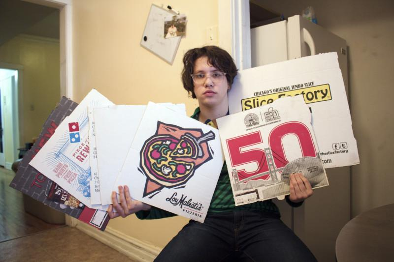 DePaul sophomore Ian Gaetz holds his pizza boxes as a badge of honor. Gaetz created a fake profile on Tinder as a woman, seducing men to order him free pizza. (Photo by Mariah Woelfel | The DePaulia)