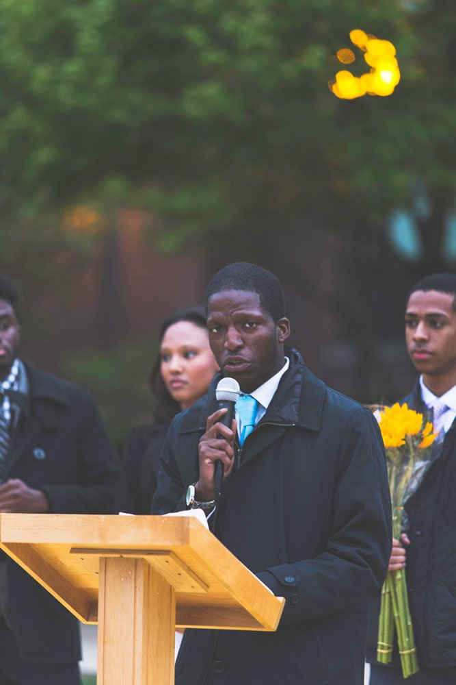 DePaul student Edward Ward speaks at an on-campus vigil. Ward's eventual goal is to run for office. (Josh Leff / The DePaulia)