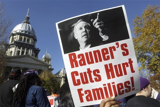 FILE - In this Nov. 10, 2015 file photo, protesters rally in support of lawmakers ending the state budget impasse at the Illinois state Capitol in Springfield. Gov. Bruce Rauner takes pride in not being like any of Illinois' previous governors. Unlike even his Republican predecessors, who often cut deals with Democrats and their labor union allies in the Legislature, Rauner brags about being the first to stand up to them, even as it's led to a record-breaking stalemate. Seven months after Illinois' last state budget expired, it still doesn't have a new one. (AP Photo/Seth Perlman, File)