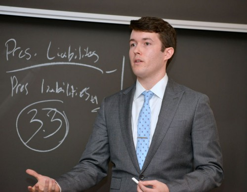A student competes in the Public Pension Crisis Student Case Competition, held last week at the Loop campus. (Photo courtesy of Kathy Hillegonds)