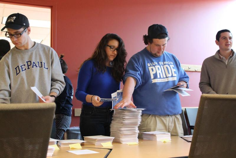 SGA members gather postcards to bring to Springfield. SGA and students will advocate for MAP April 20. (Maddy Crozier / The DePaulia)