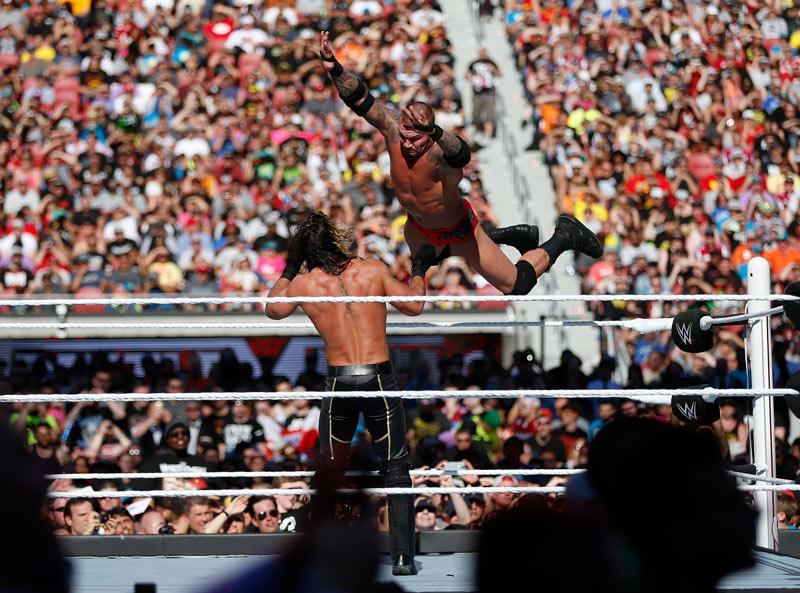 Randy Orton dives on Seth Rollins at Wrestlemania 31 in April, 2015 at Levi's Stadium in Santa Clara, California. (Nhat V. Meyer / MCT)