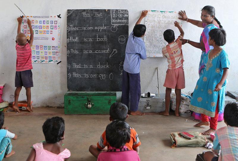 Young children work on their letters and numbers in a morning class at Dr. Subbarao Polineni's school in Martur, India. India has a high rate of malnourished children and Food for Education aims to get children back into schools. (J.B. Forbes | MCT Campus)