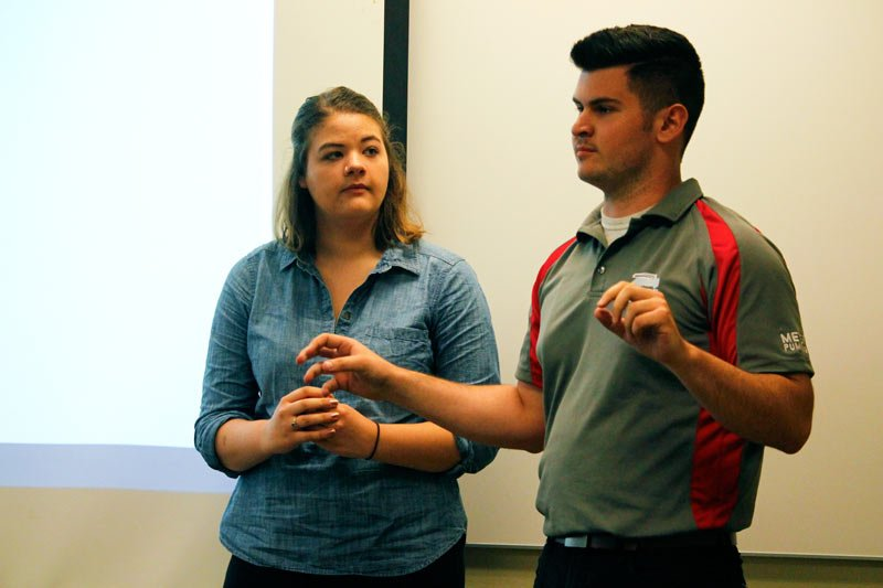 Candidates for SGA presdident and vice president Ric Popp and Megan Scoville address a group gathered for a candidate meeting Wednesday. Popp and Scoville are running unopposed. (Kirsten Onsgard / The DePaulia)