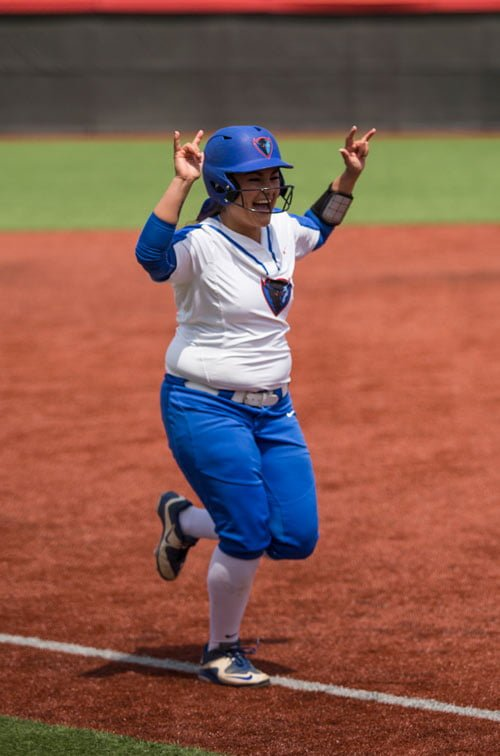 Naomi Tellez celebrates after hitting a grand slam in the Big East semifinals. (Geoff Stellfox / The DePaulia)