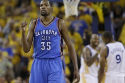 FILE - In a Monday, May 30, 2016 file photo, Oklahoma City Thunder forward Kevin Durant (35) reacts during the second half of Game 7 of the NBA basketball Western Conference finals against the Golden State Warriors in Oakland, Calif. Durant announced Monday, July 4, 2016, that he is joining All-Stars Stephen Curry and Klay Thompson with the Golden State Warriors.  Durant made the decision public on The Players' Tribune Monday morning. He can't officially sign until July 7.  (AP Photo/Marcio Jose Sanchez, File)
