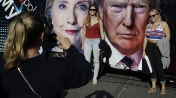 Students pose for photographs near the presidential debate between Democratic presidential candidate Hillary Clinton and Republican presidential candidate Donald Trump at Hofstra University Monday, Sept. 26, 2016, in Hempstead, N.Y. (AP Photo/Frank Franklin II)