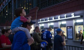Though the Cubs lost last night, fans across multiple generations unite because of the team and their hope for the team (Geoff Stellfox | The DePaulia)