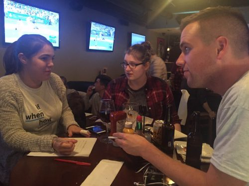 Pictured from left to right: DePaul law students Alex Cox, Katie Wuerstl and Joey Droter mull over a question If/When How's sex trivia night. (Emma Krupp/The DePaulia)