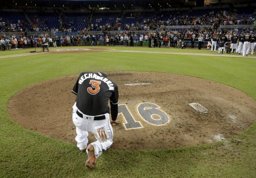 Miami Marlins' Adeiny Hechavarria (3) touches the pitcher's mound with the number 16 in honor of Marlins pitcher Jose Fernandez, after a baseball game against the New York Mets, Wednesday, Sept. 28, 2016, in Miami. Fernandez was killed in a boating accident in Miami Sunday. The Mets defeated the Marlins 5-2. (AP Photo/Lynne Sladky)