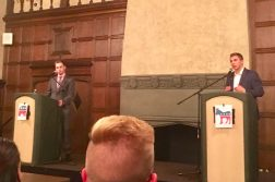 DePaul students John Minster and Jack McNeil debate Monday night. (Courtesy of Evan Keller)