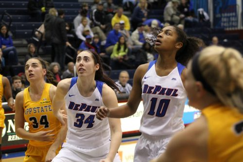 Senior forward Jacqui Grant (left) and junior guard Amarah Coleman (right) wait for a rebound. (Caroline Stacey / The DePaulia)