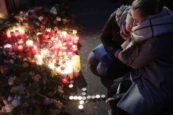 Two women mourn beside candles in Berlin, Germany, Tuesday, Dec. 20, the day after a truck ran into a crowded Christmas market nearby and killed several people. (Markus Schreiber | AP Photo)