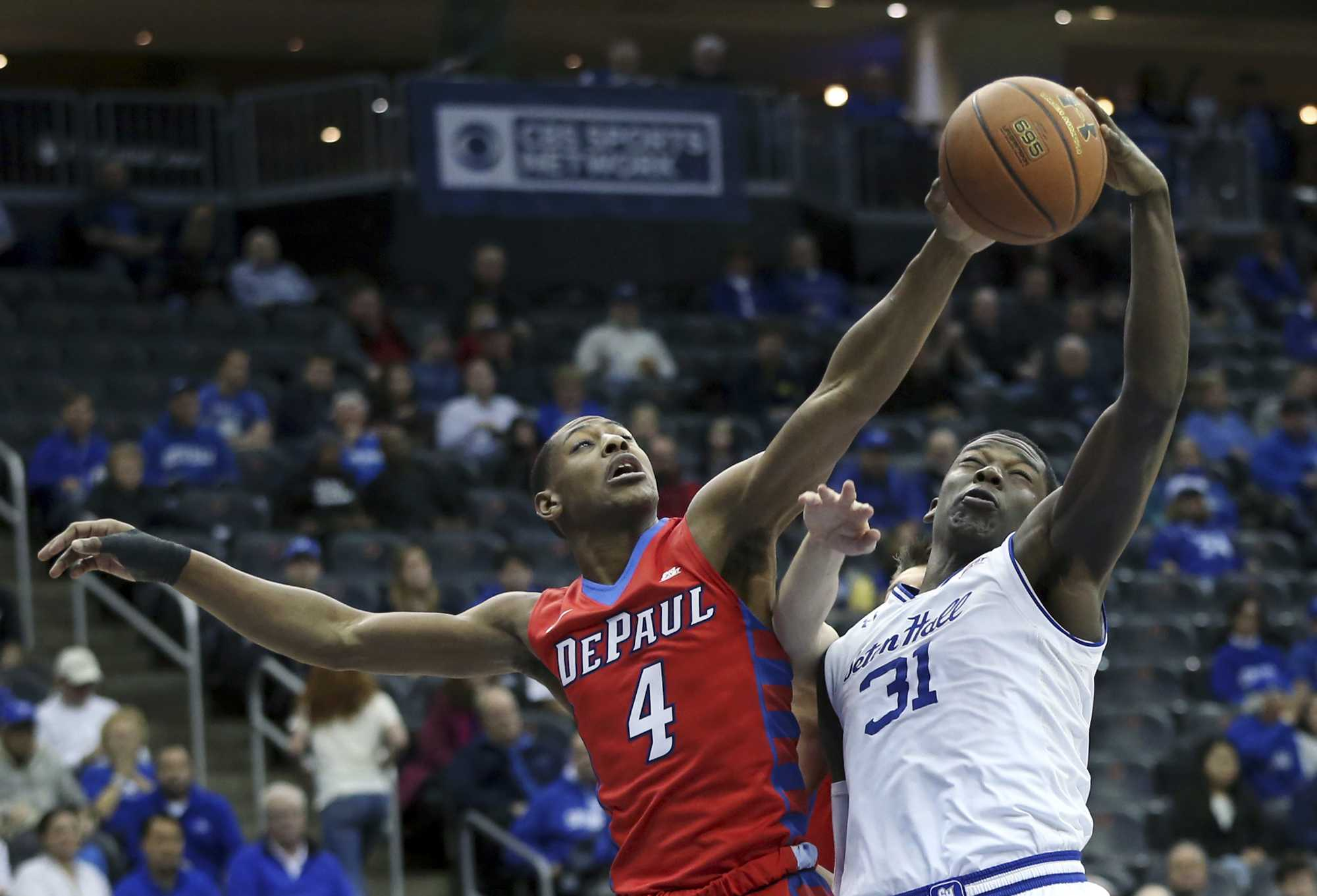 DePaul guard Brandon Cyrus (4) vies for the ball with Seton Hall forward Angel Delgado (31) during the first half of an NCAA college basketball game Saturday, Jan. 7, 2017, in Newark, N.J. AP Photo/Mel Evans)