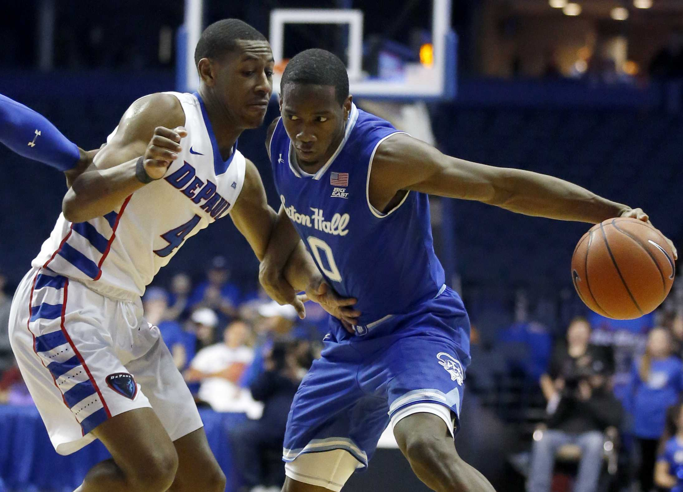 Seton Hall guard Khadeen Carrington, right, drives against DePaul guard Brandon Cyrus during the first half of an NCAA college basketball game Saturday, Feb. 25, 2017, in Rosemont, Ill. (AP Photo/Nam Y. Huh)