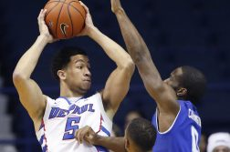 DePaul guard Billy Garrett Jr., left, looks to pass as Seton Hall guard Khadeen Carrington (0) and guard Madison Jones (30) guard during the first half of an NCAA college basketball game Saturday, Feb. 25, 2017, in Rosemont, Ill. (AP Photo/Nam Y. Huh)