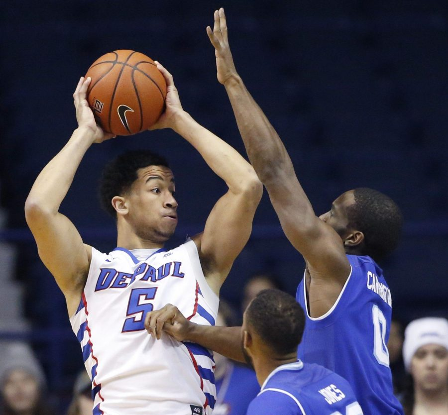 DePaul+guard+Billy+Garrett+Jr.%2C+left%2C+looks+to+pass+as+Seton+Hall+guard+Khadeen+Carrington+%280%29+and+guard+Madison+Jones+%2830%29+guard+during+the+first+half+of+an+NCAA+college+basketball+game+Saturday%2C+Feb.+25%2C+2017%2C+in+Rosemont%2C+Ill.+%28AP+Photo%2FNam+Y.+Huh%29