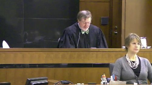 This still image taken from United States Courts shows Judge James Robart listening to a case at Seattle Courthouse on March 12, 2013 in Seattle. Robart placed a nationwide hold on President Donald Trump's executive order, banning travel to the United States by migrants from seven Muslim-majority countries, Friday, Feb. 3, 2017. (United States Courts via AP)
