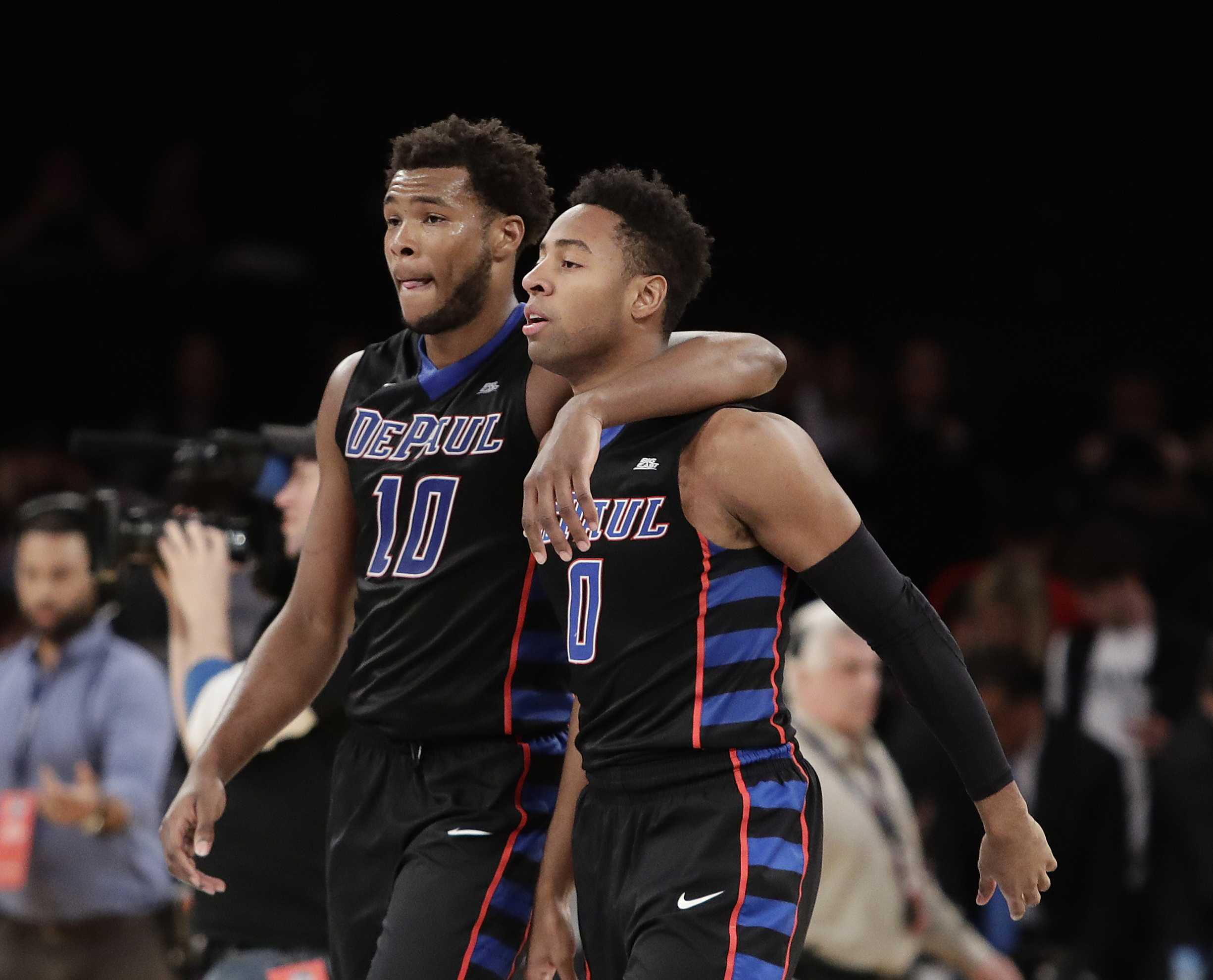 DePaul's Tre'Darius McCallum (10) and R.J. Curington (0) leave the court after the team's NCAA college basketball game against Xavier during the Big East men's tournament Wednesday, March 8, 2017, in New York. Xavier won 75-64. (AP Photo/Frank Franklin II)