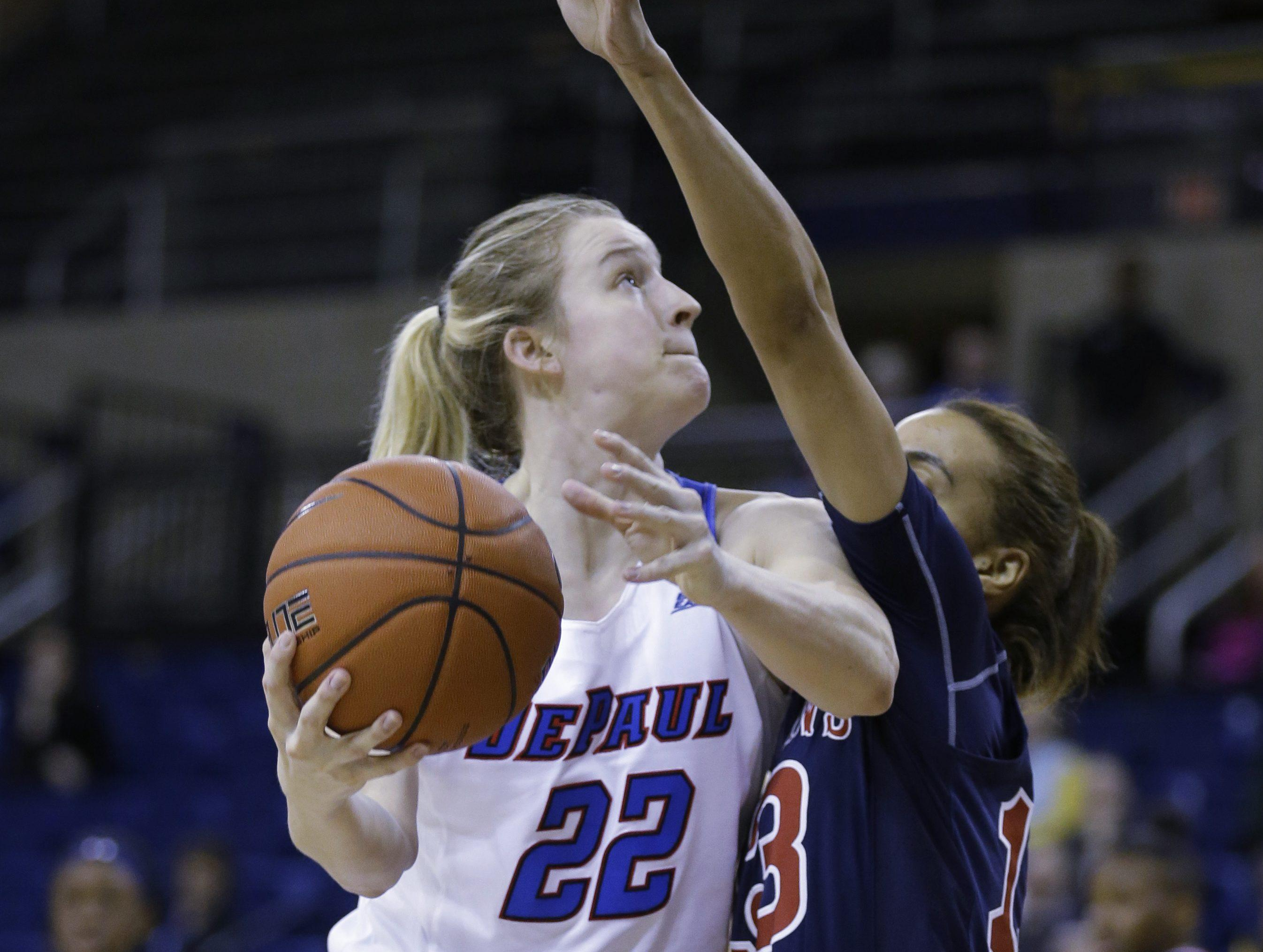 DePaul's Brooke Schulte (22) drives against St. John's Crystal Simmons during the first half of an NCAA women's semifinal Big East tournament game, Monday, March 6, 2017, at the Al McGuire Center in Milwaukee. (AP Photo/Jeffrey Phelps)