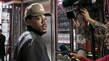 Grammy-winning artist Chance the Rapper meets with reporters at the Thompson Center in Chicago after a meeting with Illinois Gov. Bruce Rauner on Friday, March 3, 2017. (Ashlee Rezin / ASSOCIATED PRESS)