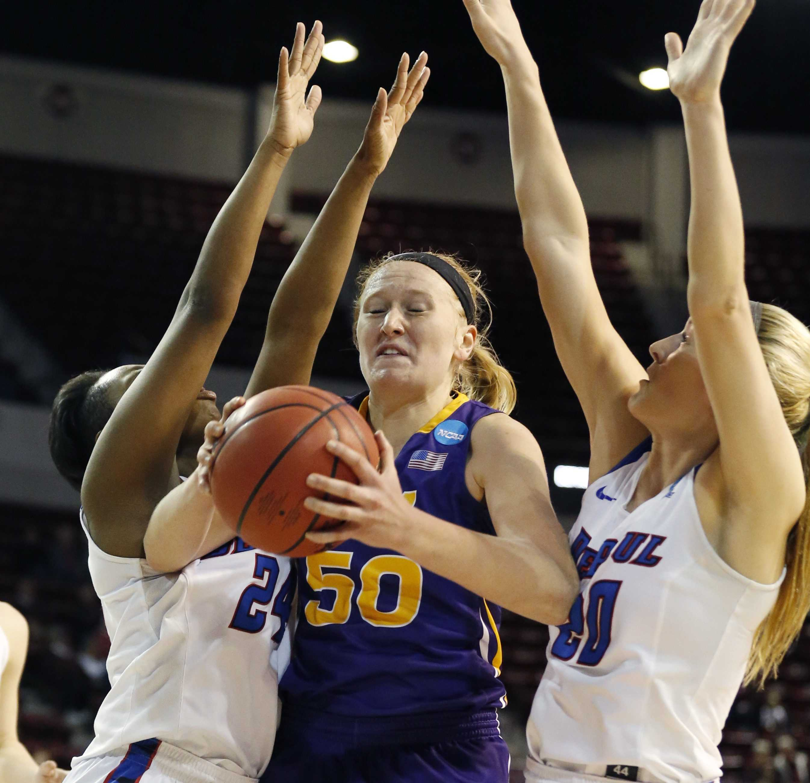 Northern Iowa forward Megan Maahs (50) pulls down a rebound between two DePaul defenders during the first half of a first-round game in the women's NCAA college basketball tournament in Starkville, Miss., Friday, March 17, 2017. (AP Photo/Rogelio V. Solis)