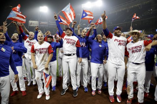 Members of the Puerto Rico team celebrate after defeating the United States 6-5 in a second-round World Baseball Classic baseball game Friday, March 17, 2017, in San Diego. (AP Photo/Gregory Bull)