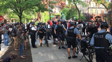 Public Safety officers gather outside of the main entrance of the Student Center during a protest May 30.  One person was allegedly stabbed and another allegedly shocked with a stun gun. Danielle Church | The DePaulia