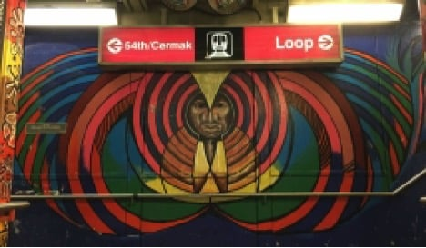 Aztec inspired art decorates the 18th street Pink line station.