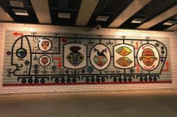 Artist David Lee Csicsko crated the mosaic located at the Belmont train stop.