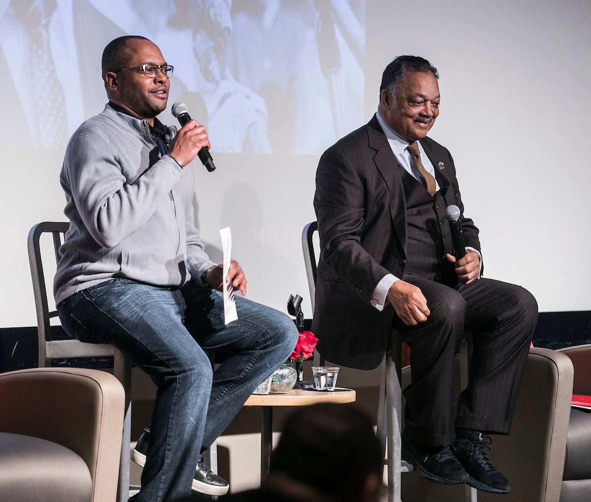 Horace Hall, left, associate professor in the College of Education at DePaul University and civil rights leader, the Rev. Jesse L. Jackson Sr., kick off a discussion at DePaul University.