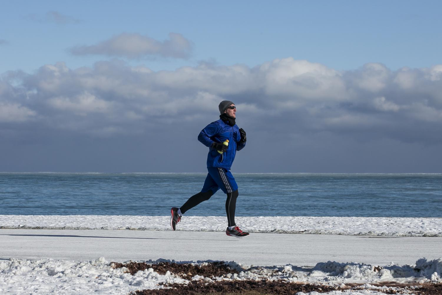 Chicago Map Loop%0A A jogger braves negative temperatures to run along the Lakefront in the  frigid early hours of