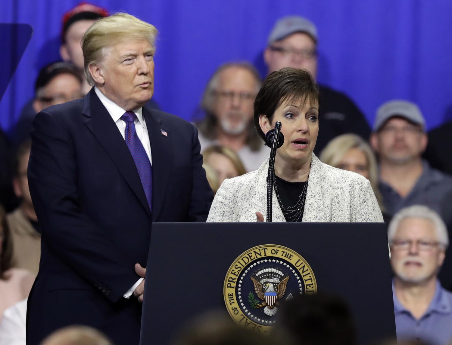 Deana Spoleti speaks as President Donald Trump listens during a speech a visit to Sheffer Corporation, Monday, Feb. 5, 2018, in Blue Ash, Ohio. (AP Photo/Evan Vucci)
