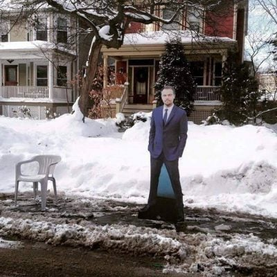 Some Chicagoans spend hours shoveling out parking spaces after snowy conditions. This spot is claimed by a Leonardo DiCaprio cardboard cutout. (Jonathan Ballew | The DePaulia)