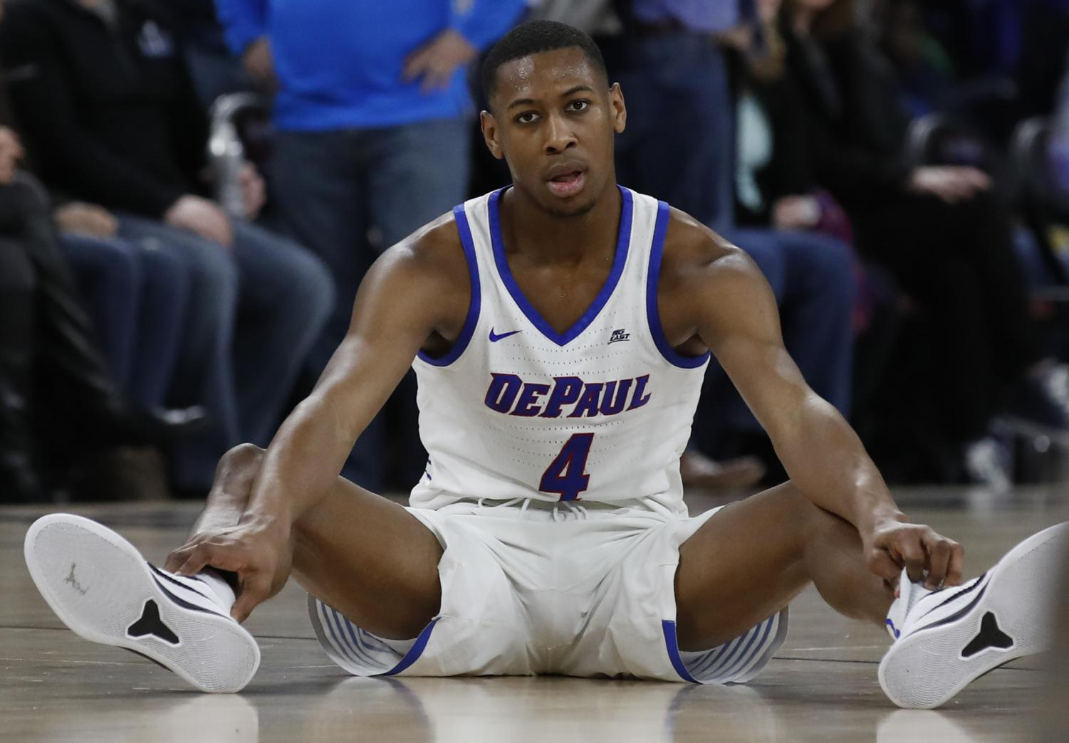 The Blue Demons (Pictured: Brandon Cyrus) looked deflated after coming up just shy of an upset in DePaul's final regular season game. before the Big East.  (Jim Young | AP News)