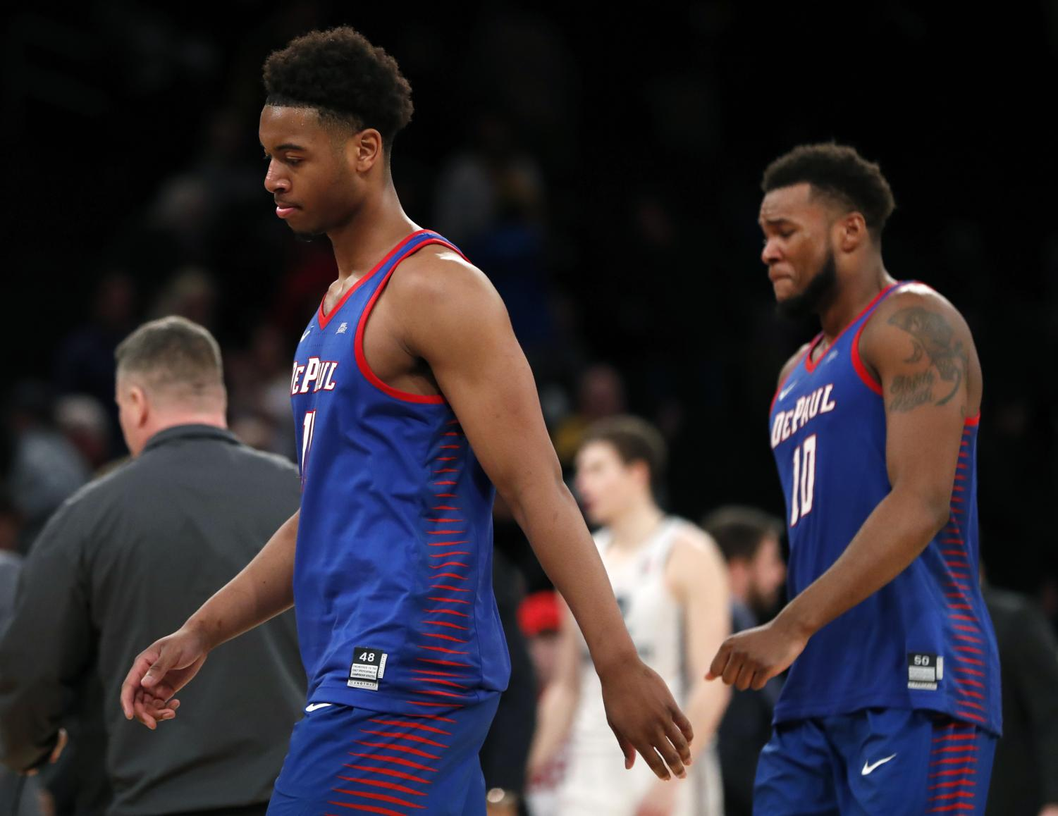 Eli Cain and Tre'Darius McCallum walking off the court at Madison Square Garden after Wednesday's season ending loss.  (AP Photo/Kathy Willens)