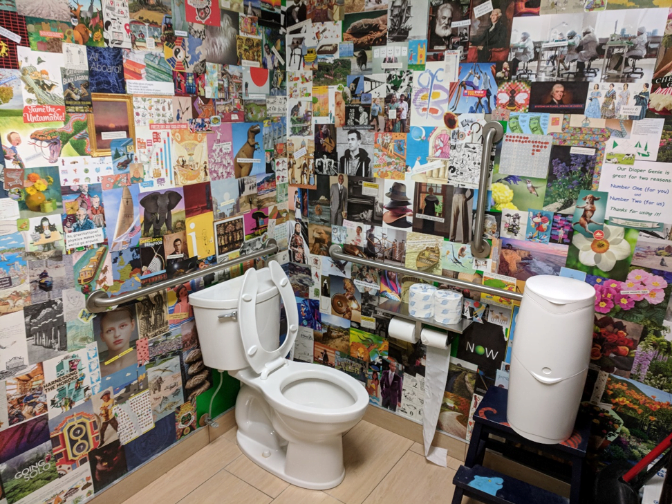 The bathroom in Open Books definitely has the most interesting and engaging wall art out of any of the bathrooms on this list.  They have various cuttings and prints pasted on the wall.  Though it is a single person bathroom, it also has a diaper changing station.  The drawback is that the view from the toilet is of supplies for the bathroom.  But at least you know that they won't run out. Open Books is located at 651 W Lake St, Chicago, IL 60661 in the West Loop. (William Sullivan | The DePaulia)