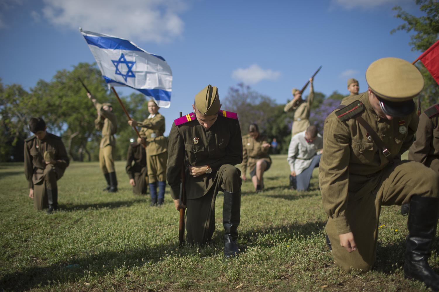 A World War II reenactment group celebrates Israel Victory Day in Ashdod, Israel on May 9, 2018
