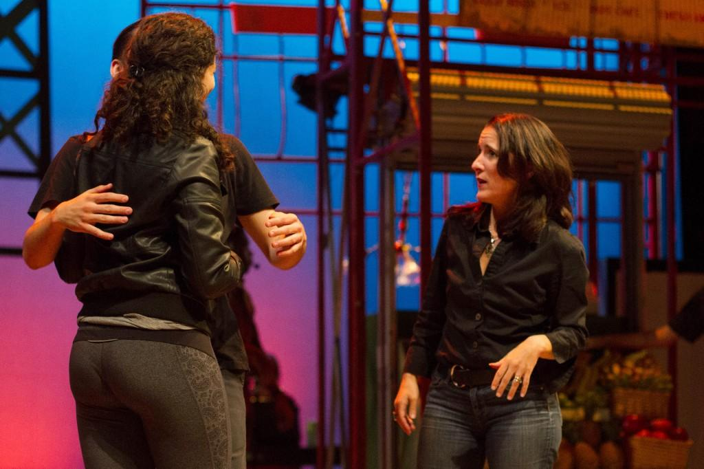 Director Lisa Portes provides direction while onstage during a tech rehearsal Sept. 19 (Grant Myatt / The DePaulia)