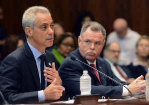 Chicago Mayor Rahm Emanuel speaks before the House-Senate Joint Criminal Reform Committee in Chicago, Tuesday, Sept. 23, 2014. Emanuel asked state legislators to make possession of less than 1 gram of any controlled substance a misdemeanor in Illinois and possession of less than 15 grams of marijuana a ticketable offense. Looking on at right is Chicago Police Superintendent Garry McCarthy. (AP Photo/Sun-Times Media, Brian Jackson)