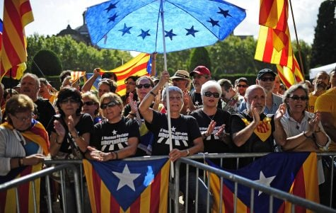Spanish Catalans show their support for independence from Spain. Photo by Manu Fernandez/AP.