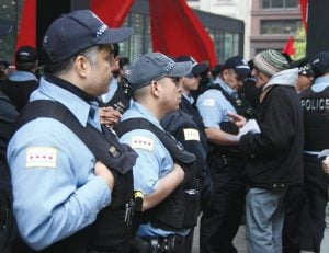 Chicago police officers gather in the Dirksen Federal Building Plaza. The organization is open to emerging ideas about the inclusion of body cameras on officers. (Photo courtesy of ALLAN J. AGUILAR)