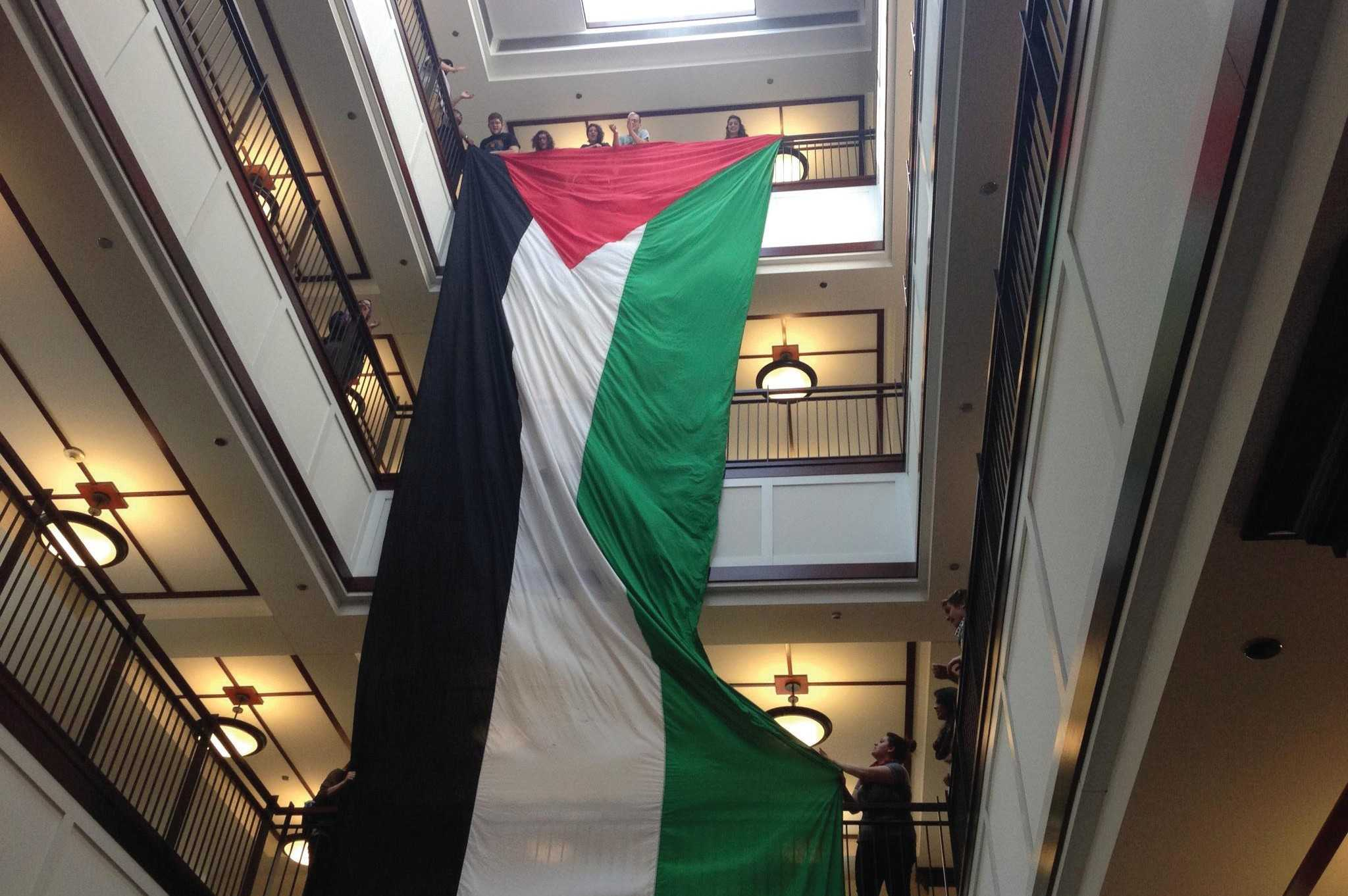 Supporters of DePaul Divest dropped a Palestinian flag Wednesday, May 21 in Arts & Letters Hall. (Matt Paras / The DePaulia)